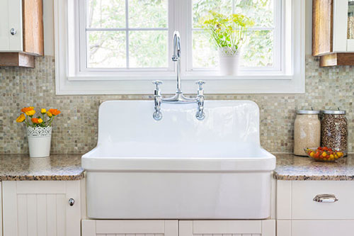 white farmhouse-style kitchen sink